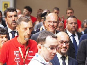 Il presidente del Consiglio, Enrico Letta, accompagnato da Emilia Guarnieri, arriva all'edizione 2013 del Meeting di Cl a Rimini,18 agosto 2013. ANSA/PASQUALE BOVE