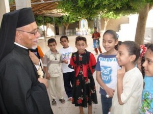 Egypt, diocese of Assiut-CPT 21.08.2006 Bishop Kyrillos William - Coptic-Catholic with children during the pilgrimage in Deir Dronka. Project trip of Marie-Ange Siebrecht