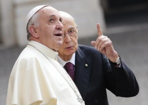 Italian President Napolitano talks with Pope Francis as he arrives for a meeting at the Quirinal Palace in Rome