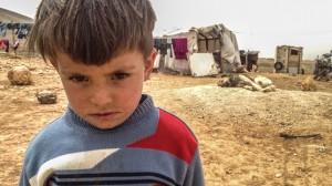 Bimbo siriano, provato dalla fame e dalla guerra.