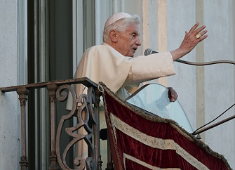 Pope Benedict XVI blesses as he appears for the last time at the balcony of his summer residence in Castelgandolfo