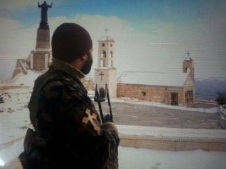 Guardia militare a salvaguardia del patrimonio religioso in Siria