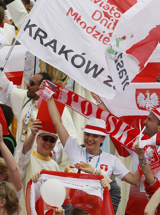 Polish pilgrims in Rio de Janeiro cheer as Pope Francis announces that World Youth Day 2016 will take place in Krakow, Poland. The pope made the announcement at the conclusion of the closing Mass of World Youth Day on Copacabana beach July 28. (CNS photo/Paul Haring) (July 28, 2013) See WYD-2016 July 28, 2013.