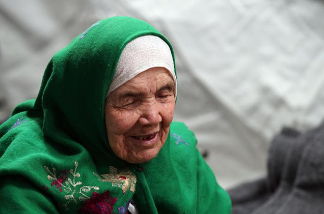 105-year old Afghan regugee Bibihal Uzbeki from Kunduz, Afghanistan, rests in Croatia's main refugee camp at Opatovac, Croatia, near the border with Serbia, Tuesday, Oct. 27, 2015. Centenarian Bibihal Uzbeki, crossed into Croatia on a stretcher from Serbia with a large group of refugees, including her son and several other relatives, among tens of thousands who have traveled across continents, fleeing war and poverty to search for a happier, safer future in Europe. (ANSA/AP Photo/Marjan Vucetic)