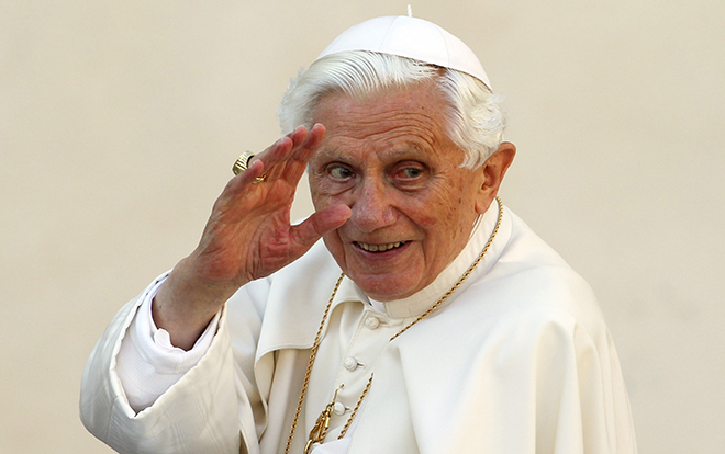 Pope Benedict XVI waves as he arrives to lead the Wednesday general audience in Saint Peter's square at the Vatican