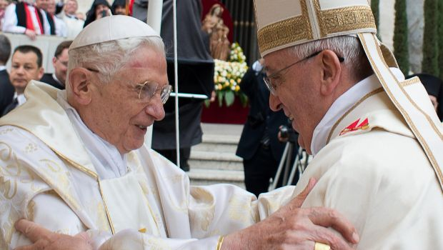 "ALTERNATIVE CROP - This handout picture released on April 27, 2014 by the Vatican press office shows Pope Francis (R) meeting with Pope emeritus Benedict XVI during the canonisation mass of Popes John XXIII and John Paul II on St Peter's square at the Vatican on April 27, 2014. Catholics from around the world gathered in Rome on Sunday for a mass presided by Pope Francis to confer sainthood on John Paul II and John XXIII -- two influential popes who helped shape 20th century history. AFP PHOTO / OSSERVATORE ROMANO/HO RESTRICTED TO EDITORIAL USE - MANDATORY CREDIT ""AFP PHOTO / OSSERVATORE ROMANO"" - NO MARKETING NO ADVERTISING CAMPAIGNS - DISTRIBUTED AS A SERVICE TO CLIENTS"