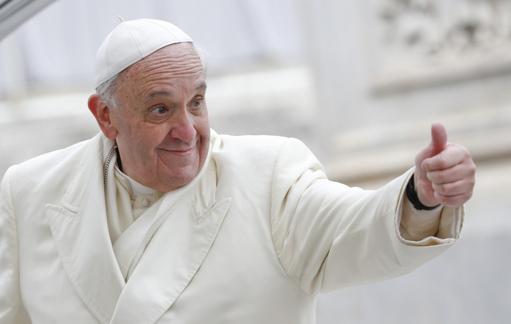 Pope Francis gives the thumbs up during his general audience in St. Peter's Square at the Vatican Jan. 29. (CNS photo/Tony Gentile, Reuters) (Jan. 29, 2014) See POPE-AUDIENCE Jan. 29, 2014.
