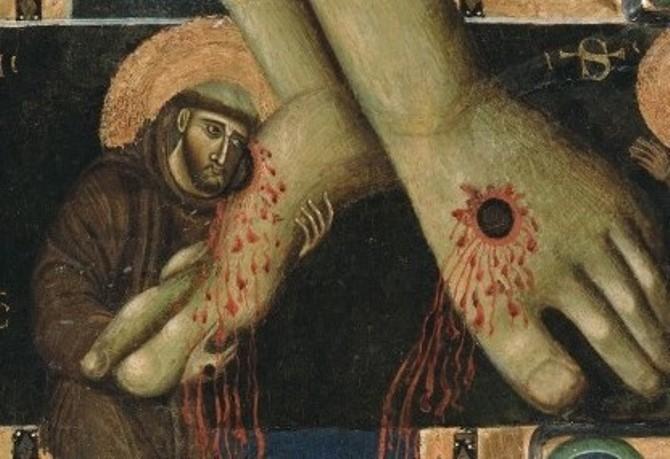 San Francesco abbraccia i piedi di Cristo-