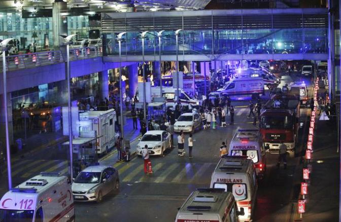 Security and rescue personnel gather outside Istanbul's Ataturk airport, early Wednesday, June 28, 2016. Two explosions have rocked Istanbul's Ataturk airport Tuesday, killing several people and wounding scores of others, Turkey's justice minister and another official said. A Turkish official says two attackers have blown themselves up at the airport after police fired at them. The official said the attackers detonated the explosives at the entrance of the international terminal before entering the x-ray security check. Turkish authorities have banned distribution of images relating to the Ataturk airport attack within Turkey. (ANSA/AP Photo/Emrah Gurel) TURKEY OUT
