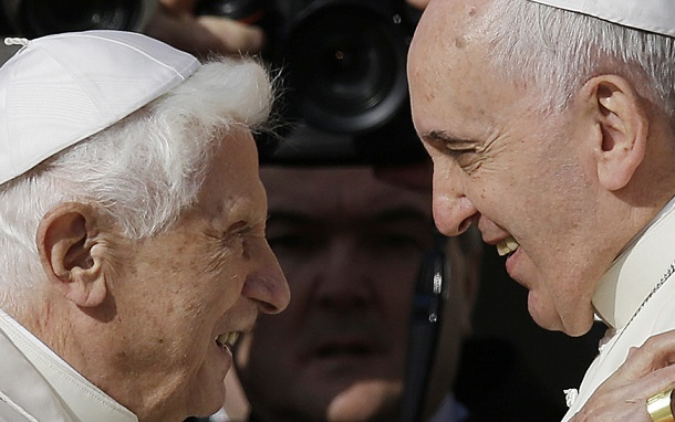 Pope Francis, right, hugs Pope Emeritus Benedict XVI prior to the start of a meeting with elderly faithful in St. Peter's Square at the Vatican, Sunday, Sept. 28, 2014. (AP Photo/Gregorio Borgia)