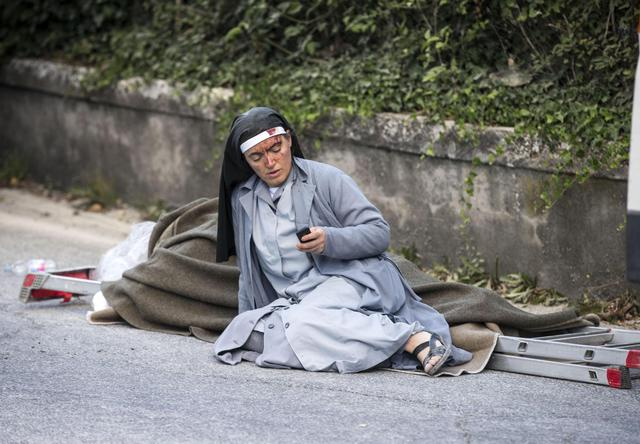 A injured nun in Amatrice, central Italy, where a 6.1 earthquake struck just after 3:30 a.m., Wednesday, Aug. 24, 2016. The quake was felt across a broad section of central Italy, including the capital Rome where people in homes in the historic center felt a long swaying followed by aftershocks. ANSA/ MASSIMO PERCOSSI