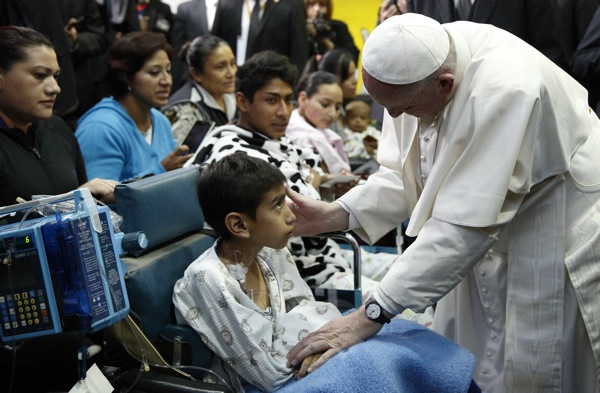 Pope Francis greets a sick child during a visit to the Federico Gomez Children's Hospital of Mexico in Mexico City Feb. 14. (CNS photo/Paul Haring) See POPE-MEXICO-HOSPITAL Feb. 14, 2016.
