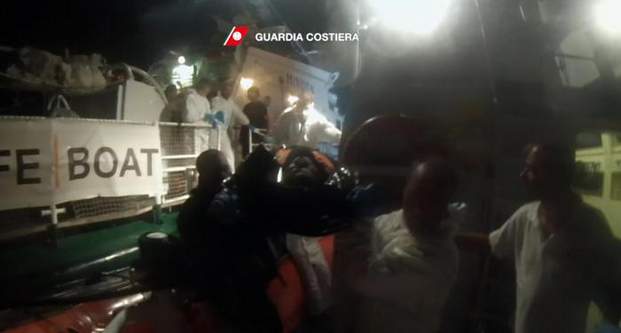 A handout frame video provided on 05 October 2016 and released on 04 October by the Italian Coast Guard shows migrants during a rescue operation conducted by Boats CP302 and CP322 near Lampedusa. Boats saved more than 300 migrants boarding them on 4 rubbers dinghy. ANSA/ ITALIAN COAST GUARD PRESS OFFICE +++ANSA PROVIDES ACCESS TO THIS HANDOUT PHOTO TO BE USED SOLELY TO ILLUSTRATE NEWS REPORTING OR COMMENTARY ON THE FACTS OR EVENTS DEPICTED IN THIS IMAGE; NO ARCHIVING; NO LICENSING+++