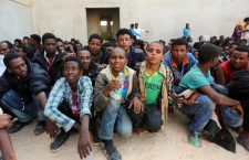 Men and boys, part of some 340 illegal migrants who were rescued by the Libyan navy off the coast of the western town of Sabratha when their boat began to take on water, sit at a shelter on May 12, 2014 in the coastal town of Zawiya, west of Tripoli. The rescue came on the same day Italy's navy said at least 14 migrants had died when their boat sank between Libya and Italy, the latest in a string of shipwreck tragedies to hit the Mediterranean. Libya has long been a springboard for Africans seeking a better life in Europe, and the number of illegal departures from its shores is rising. AFP PHOTO / MAHMUD TURKIA