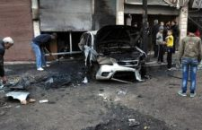 epa05783622 A handout photo made available by the official Syrian Arab News Agency (SANA) shows people standing near a burnt-out car at the site of what SANA claim to be rocket attacks, in Homs, Syria, 10 February 2017.  According to SANA, rocket attacks on the residential neighborhoods of Homs city killed one person and injured 12 others. The Syrian Observatory for Human Rights said five people were killed in regime bombings in the besieged al-Waer neighborhood in the Syrian city of Homs.  EPA/SANA HANDOUT  HANDOUT EDITORIAL USE ONLY/NO SALES