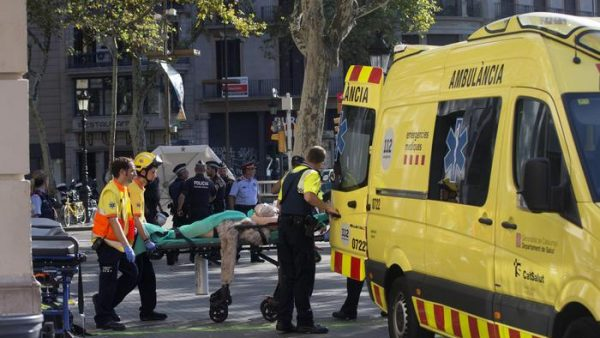 epa06148681 Mossos d'Esquadra Police officers and emergency service workers move an injured after a van crashes into pedestrians in Las Ramblas, downtown Barcelona, Spain, 17 August 2017. According to initial reports a van crashed into a crowd in Barcelona's famous Placa Catalunya square at Las Ramblas area injuring several. Local media report the van driver ran away, metro and train stations were closed. The number of people injured and the reasons behind the incident are not yet known. Official sources have not confirmed that the incident is a terrorist attack.  EPA/Quique Garcia FACES PIXELATED BY SOURCE DUE TO LOCAL LAW