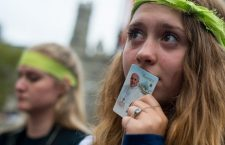 "Kat North, 14, visiting with her fellow high schoolers from St. Mary Catholic Church in Hudson, OH, holds a Papa Francisco picture to her lips as she watches the pontiff during mass on the jumbo screens in front of City Hall in Philadelphia on Sunday, Sept. 26, 2015. ""It was absolutely incredible... I've never experienced anything like it,"" said North."
