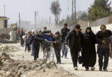 civili in fuga dalla siria