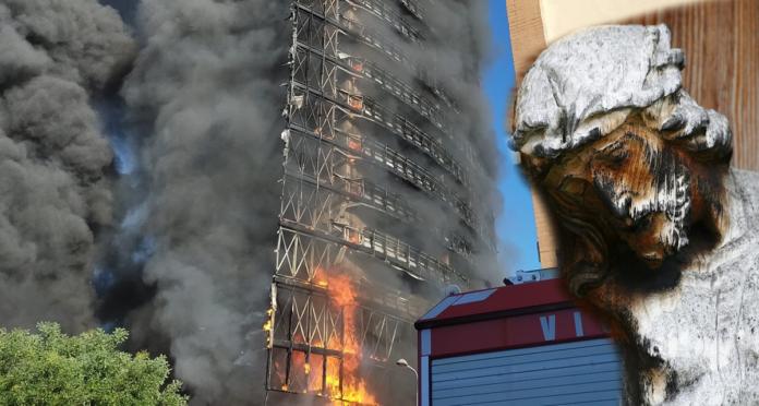 Grattacielo in fiamme a Milano: si salva un crocifisso